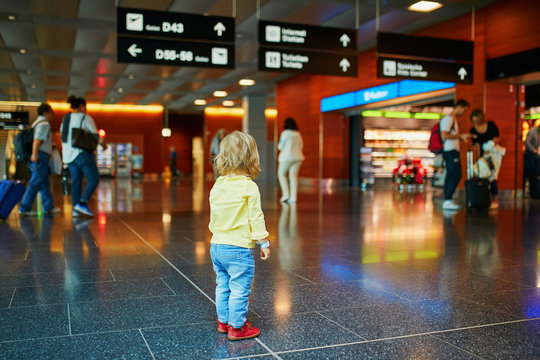 Adorable little girl alone in the airport
