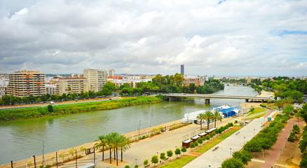 Guadalquivir river and skyline of modern Los Remedios neighborhood in Seville, Andalusia, Spain