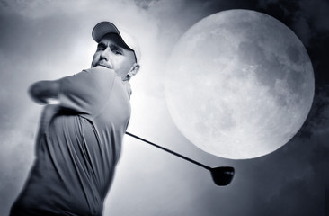 Wall Mural - golf swing and a big moon