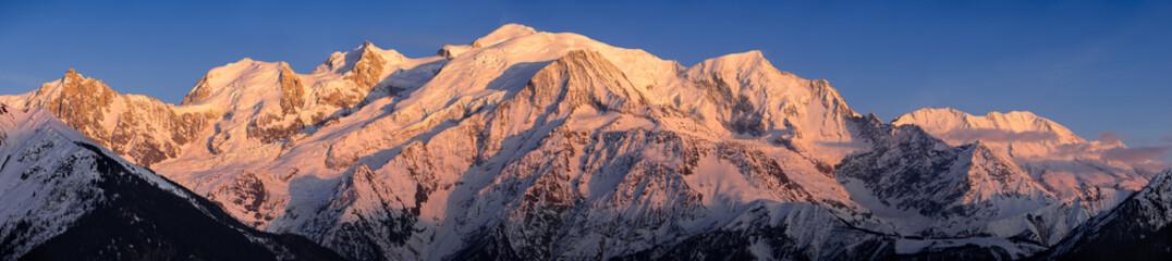 Aluminium Prints Salmon Mont Blanc mountain range at sunset. Aiguille du Midi needle, Mont Blanc du Tacul, Bossons Glacier, Mont Blanc. Chamonix, Haute-Savoie, Alps, France