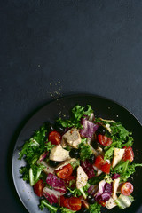 Vegetable salad with chicken and spicy citrus dressing. Top view with copy space.