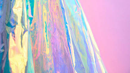 Real Hologram Background of wrinkled abstract foil texture with multiple colors. Holographic...