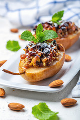Pears baked with raisins, nuts, honey and mint.