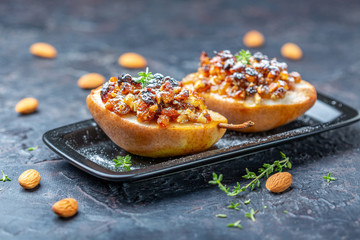 Pears with nuts, raisins and spices.
