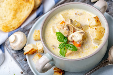 Saucepan with chicken cream soup with mushrooms.
