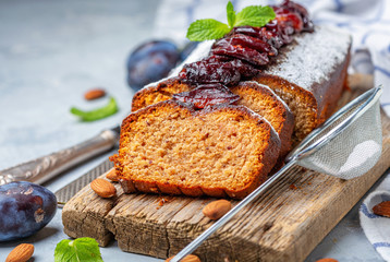 Homemade plum cake with almonds and spicy plum.