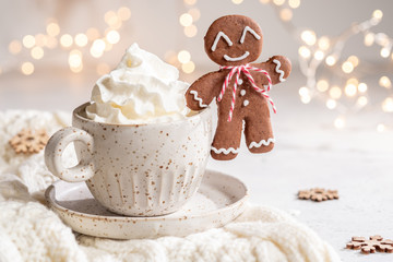Gingerbread cookie man with a hot chocolate for Christmas holiday