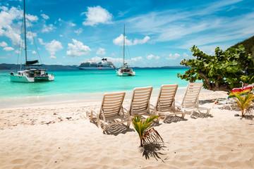 Tropical white sand beach with beach chairs. Jost Van dyke, British Virgin Islands.