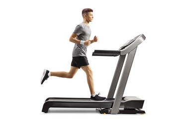 Young guy running on a professional treadmill