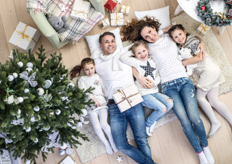 family under the Christmas tree