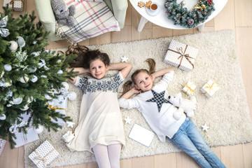little girls under the Christmas tree