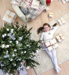 little girl under the Christmas tree