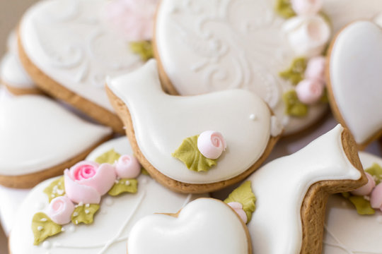 Closeup of gingerbread cookies in a white glaze. Stylish pastries as a decoration for the holidays.
