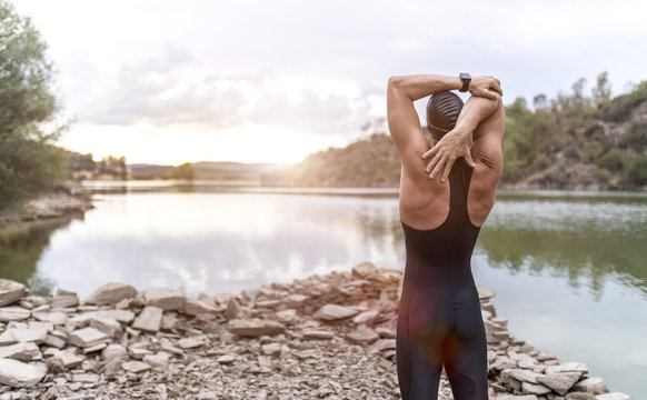 swimmer in swimsuit glasses and cap in open water