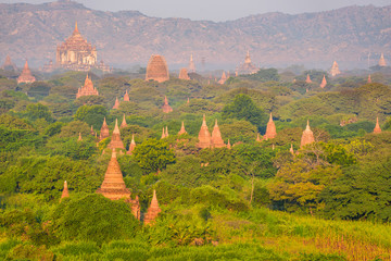 Sunrise landscape view with silhouettes of old historic temples, Bagan, Myanmar