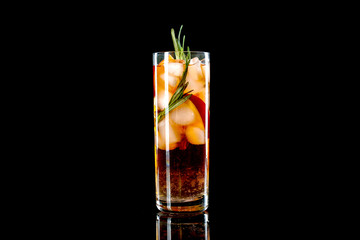 Glass of tasty cocktail on dark background