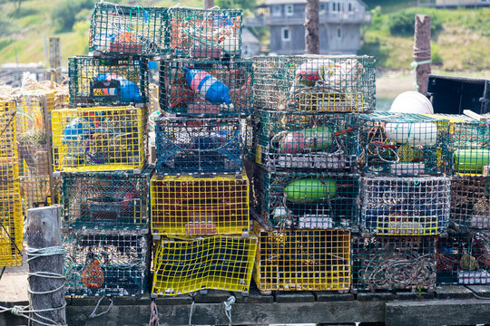 Lobster Traps piled up on a dock in Maine