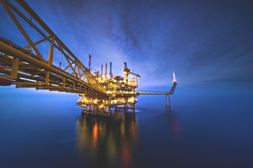 Industrial Offshore oil and gas,Oil rig platform with milky way at night
