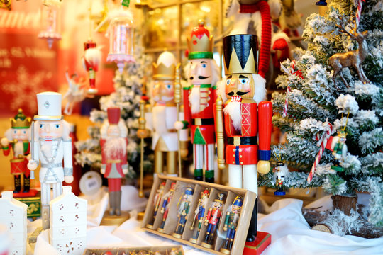 Christmas nutcracker sold at Christmas market in Vilnius, Lithuania. Decorated and illuminated shopping stands with variety of Xmas toys.
