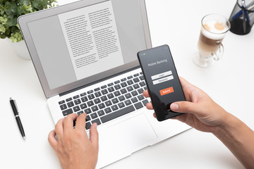 Man using mobile banking on smartphone