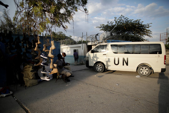 A van with the logo of the UN enters into the Logistic Base of the United Nations Mission for Justice Support in Haiti (MINUJUSTH) in Port-au-Prince