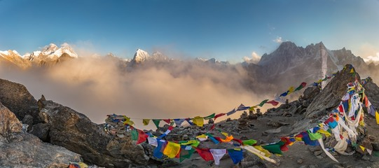 Panoramic shot of colorful Tibetan prayer flags on a mountain