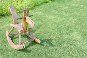 wooden rocking horse chair children on lawn