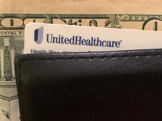 Picture illustration of a UnitedHealth Group health insurance card in a wallet