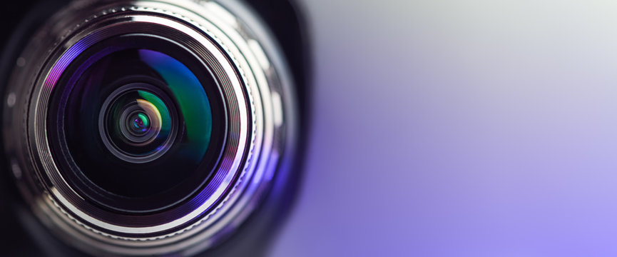 .Banner. The camera lens with purple backlight. Optics. .