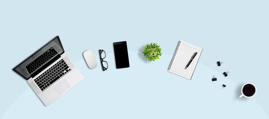 Top view office desk and supplies, with copy space. Creative flat lay photo of workspace desk/Panoramic banner background