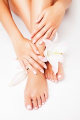 Aluminium Prints Pedicure manicure pedicure with flower lily close up isolated on white perfect shape hands spa salon