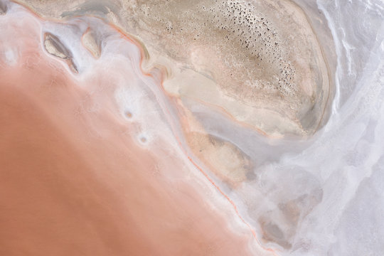 Abstract top down view of a large pink salt lake located next to highway 40 in the wheatbelt region of Western Australia