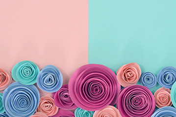 Beautiful elegant pastel paper rose flat lay background with flowers at the bottom and empty copy space above