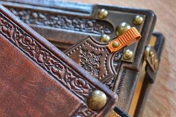 Leather bookmark peek out of the leather book
