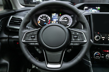 close-up of the dashboard, speedometer, tachometer and steering wheel. . modern car interior.
