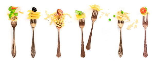 Italian food collage. Pasta design elements. Many forks with pasta and various addings, shot from the top on a white background
