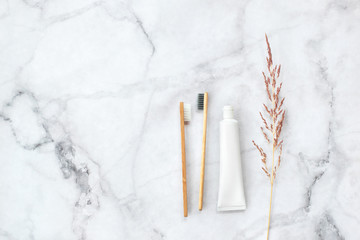 Set of eco-friendly toothbrushes and toothpaste on marble background. Dental and healthcare...