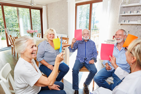 Seniors do exercise in group therapy