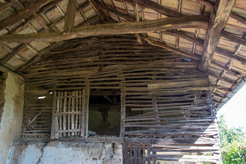 Details of an old wooden house, wooden barn structure, rural scene, interior of an abandoned house