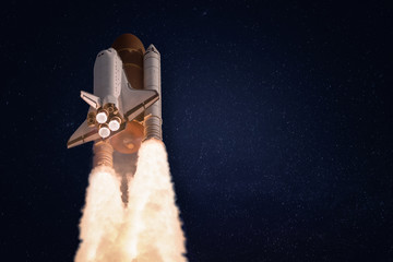 Space shuttle on dark starry background. Wallpaper with the rocket. Elements of this image furnished by NASA