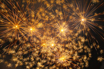Brilliant and golden fireworks against the backdrop of the night sky, Vittorio Veneto, Italy