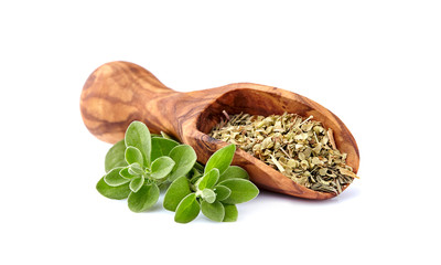 Oregano or marjoram leaves isolated on white background. Oregano fresh and dry in wooden spoon.