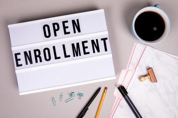 Open Enrollment concept. White lightbox
