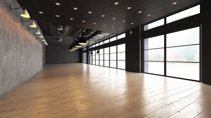 Large open empty space with concrete wall illuminated by natural light from windows