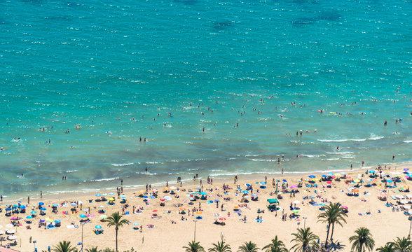 Alicante, Comunitat Valenciana / Spain - July 29th, 2019: View of the beach in summer as seen from the Santa Barbara Castle