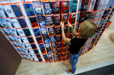 An employee sorts books during the preparations for the upcoming Frankfurt book fair in Frankfurt