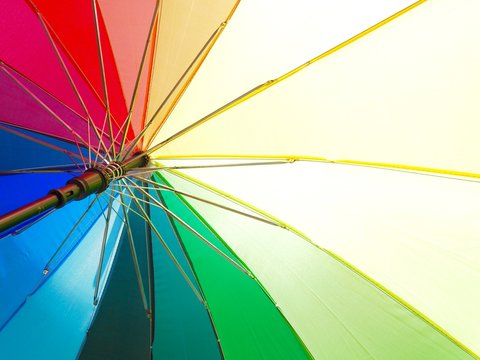 abstract background with umbrellas Bright colorful rainbow umbrella background ( LGBT concept)