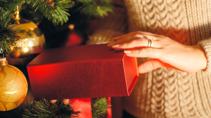 Closeup toned image of woman holding Christmas presents in hands