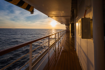 Spectacular sunrise over the sea horizon seen from the upper deck of a cruise ship, Adriatic sea, Italy