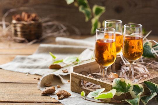 Italian almond liquor amaretto on a wooden table